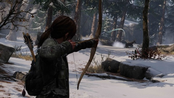 ellie aims bow at animal